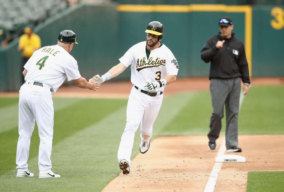 OAKLAND, CA - JUNE 07:  Trevor Plouffe #3 of the Oakland Athletics is congratulated by third base coach Chip Hale after he hit a home run in the fourth inning against the Toronto Blue Jays at Oakland Alameda Coliseum on June 7, 2017 in Oakland, California.  (Photo by Ezra Shaw/Getty Images) Photo: Ezra Shaw, Getty Images