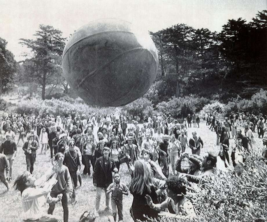 "June 21, 1967 - Crowds of hippies gather in Golden Gate Park during the ""Summer of Love"" to welcome the first day of that season. A huge inflated ball, painted to represent a globe, is kept aloft by the celebrants. Photo: Photo Credit:, Associated Press/1967"