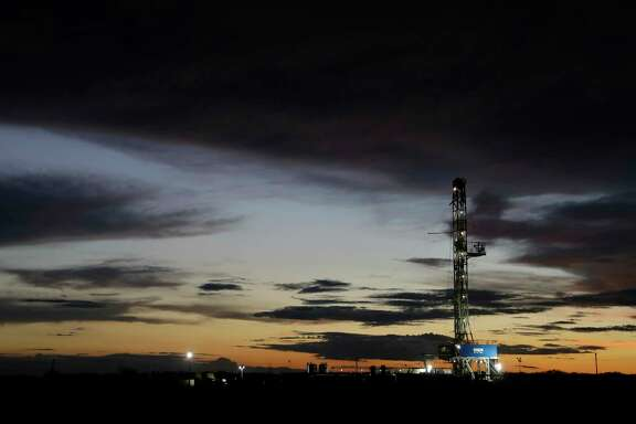 A drilling rig is seen at sun set after thunderstorm passed through the area, Monday, June 5, 2017, near Karnes City, Texas. (AP Photo/Eric Gay)