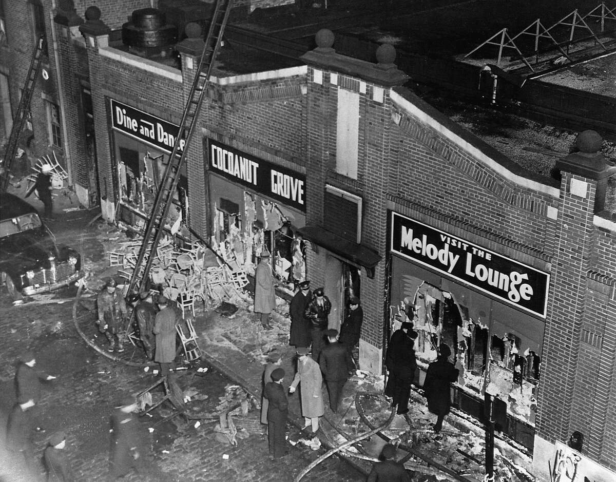 Police, firemen and the curious gather at the Cocoanut Grove nightclub in Boston, where 492 people died in a fire on Nov. 29, 1942.