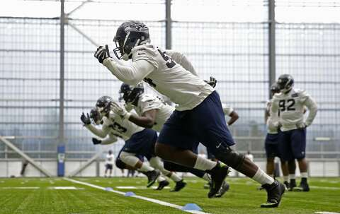 faf346712 <p>Seattle Seahawks defensive tackle Malik McDowell, center, sprints off  the line