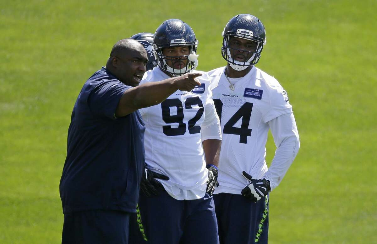 Seattle Seahawks defensive line coach Clint Hurtt, left, works with rookie defensive tackles Malik McDowell, right, and Nazair Jones (92) during NFL football practice, Friday, June 2, 2017, in Renton, Wash. (AP Photo/Ted S. Warren)