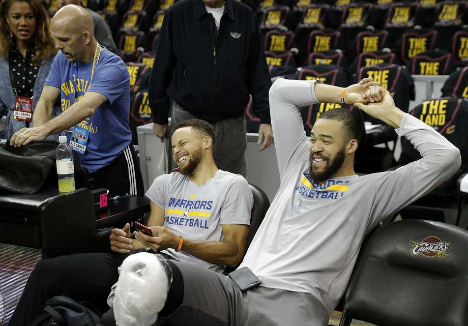 Stephen Curry and JaVale McGee share a laugh at the end of practice. Photo: Carlos Avila Gonzalez, The Chronicle