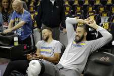 Stephen Curry (30) and JaVale McGee (1) share a laugh at the end of practice before the Golden State Warriors played the Cleveland Cavaliers in Game 3 of the NBA Finals at Quicken Loans Arena in Cleveland, Ohio, on Wednesday, June 7, 2017.
