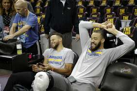 Stephen Curry and JaVale McGee share a laugh at the end of practice.