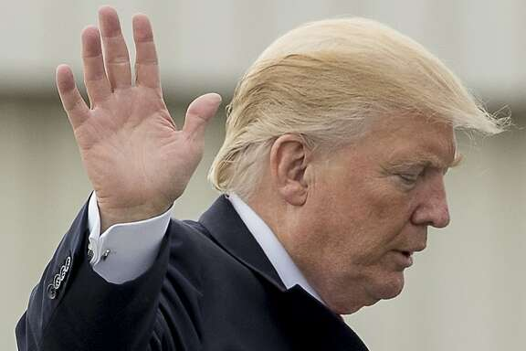 President Donald Trump waves to members of the media as he boards Air Force One at Cincinnati Municipal Lunken Airport in Cincinnati, Ohio, Wednesday, June 7, 2017, to travel to Andrews Air Force Base, Md. Trump was visiting Cincinnati to speak about healthcare and infrastructure. (AP Photo/Andrew Harnik)