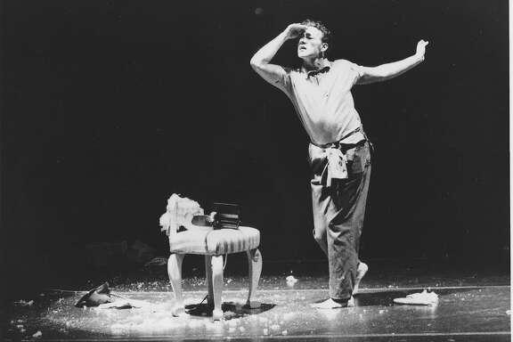 Joe Goode performs in 29 Effeminate Gestures, 1987.  Photo by Bill Pack
