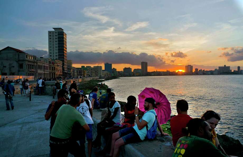 People spend the afternoon sitting on the Havana sea wall in Cuba. (AP Photo/Ramon Espinosa) Photo: Ramon Espinosa, STF / Copyright 2016 The Associated Press. All rights reserved.