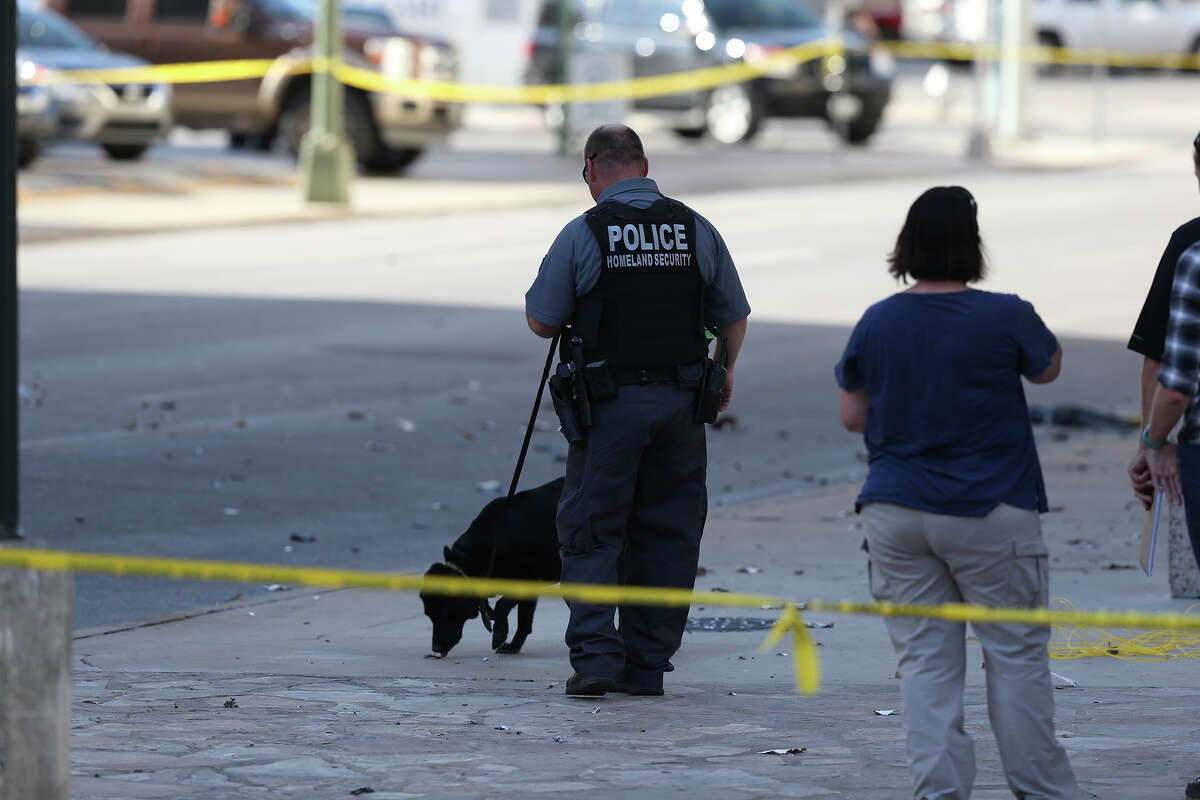 Police officials investigate the scene where a suspicious package was detonated Wednesday afternoon near the Federal building across the street from the Alamo. June 7, 2017.