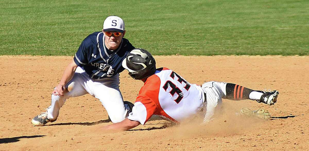 Staples second baseman Drew Rogers, left, tags out Ridgefield's Nicholas Hanna at second base on a stolen-base attempt.