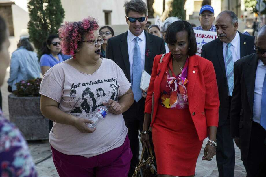 Barbie Hurtado, a community organizer wth RAICES, speaks with Mayor Ivy Taylor during a demonstration to ask the city to file a lawsuit against S.B. 4 at the Municipal Plaza building in San Antonio, Texas on May 25, 2017. Ray Whitehouse / for the San Antonio Express-News Photo: Ray Whitehouse, Photographer / For The San Antonio Express-New