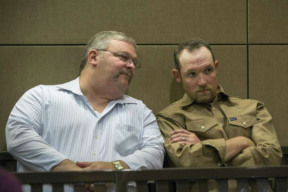 Coty Bob McDonnell (right) and Doug Stearns confer Wednesday at Bexar County Court 9. Photo: Ray Whitehouse /For The San Antonio Express-New