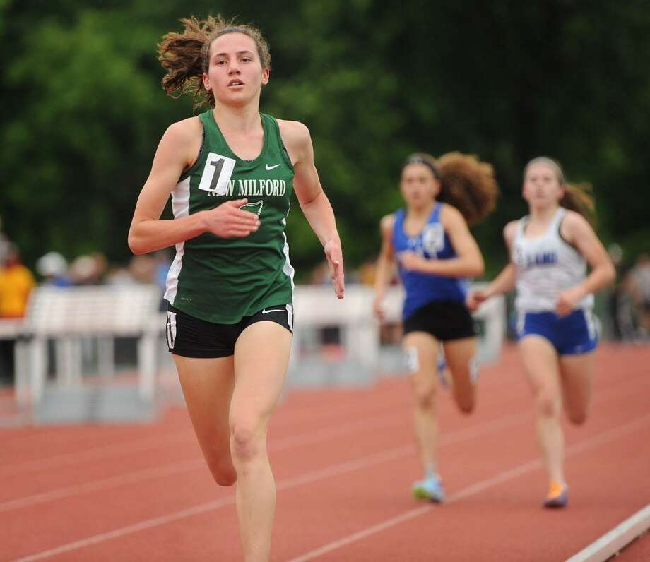 New Milford's Mia Nahom runs to an easy victory in the girls 1600 meters at the State Open outdoor track championships at Willow Brook Park in New Britain on Monday. Photo: Brian A. Pounds / Hearst Connecticut Media / Connecticut Post