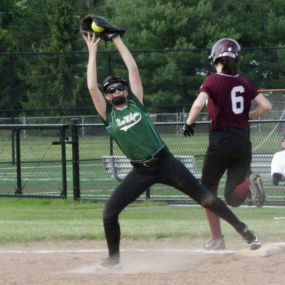 The New Milford High School JV softball team fell 6-3 to Bethel May 19. Second baseman, freshman Paige Duffany, covers the bag at first and makes the catch to get the out at first. Photo: Courtesy Of Katie Alzapiedi / The News-Times Contributed