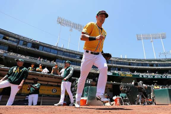 OAKLAND, AZ - JUNE 04:  Infielder Chad Pinder #18 of the Oakland Athletics runs out onto the field during the MLB game against the Washington Nationals at Oakland Coliseum on June 4, 2017 in Oakland, California.  The Nationals defeated the Athletics  11-10.  (Photo by Christian Petersen/Getty Images)