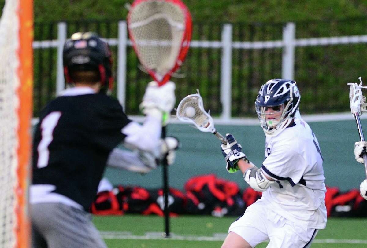 Wilton's Connor Drake drives towards the goal during Class L boys lacrosse semi-final action against Cheshire in at Fairfield University in Fairfield, Conn. on Wednesday June 7, 2017. Defending is Cheshire goalie Peter Brown.