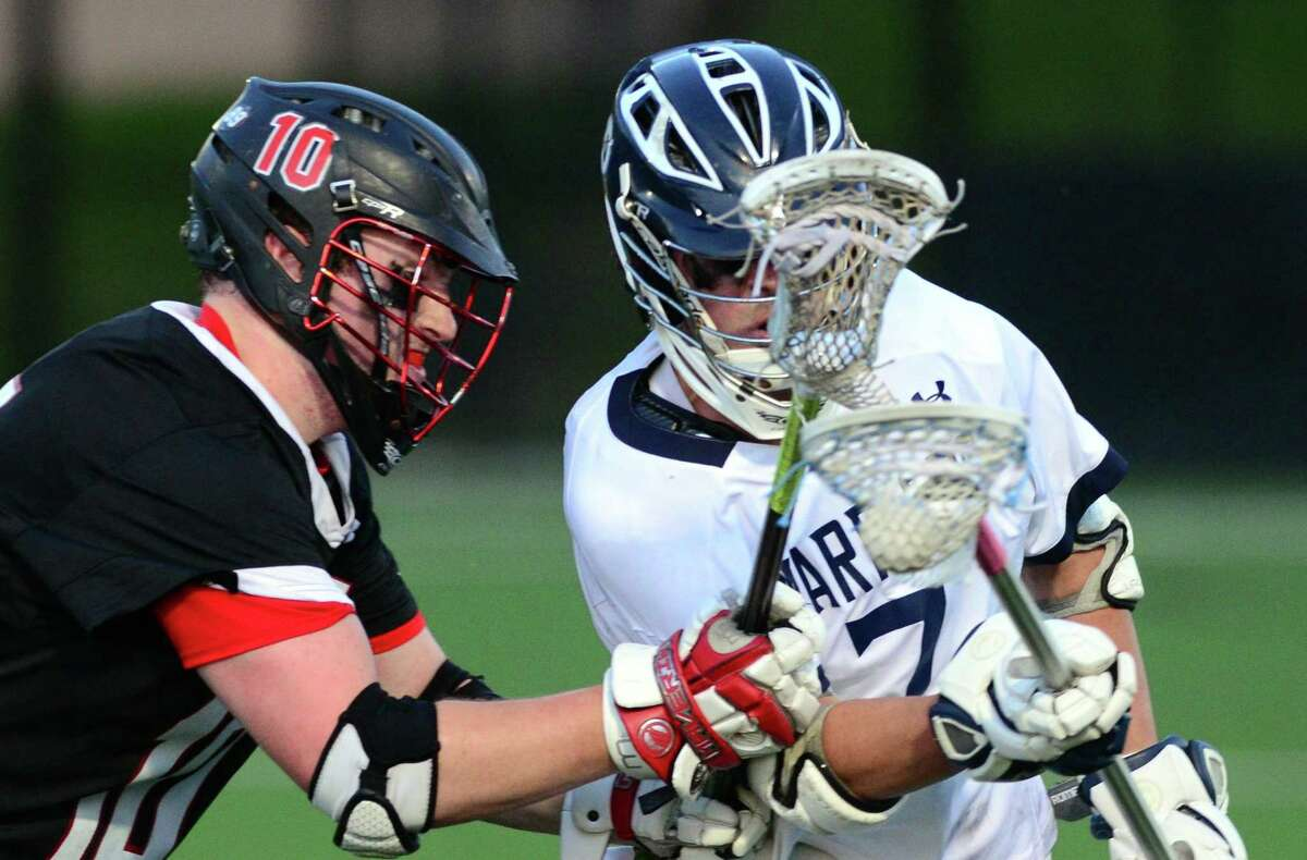 Cheshire's Daniel Covel, left, tries to cut off Wilton's Joseph Scarfi during Class L boys lacrosse semi-final action against Cheshire in at Fairfield University in Fairfield, Conn. on Wednesday June 7, 2017.