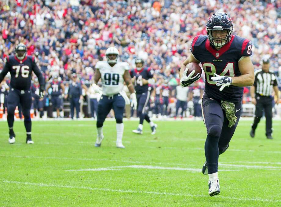 Houston Texans tight end Ryan Griffin (84) heads for the end zone on a touchdown reception during the first quarter of an NFL football game Tennessee Titans at NRG Stadium on Sunday, Nov. 30, 2014, in Houston. ( Brett Coomer / Houston Chronicle ) Photo: Brett Coomer, Staff / © 2014  Houston Chronicle