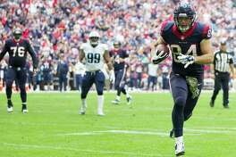 Houston Texans tight end Ryan Griffin (84) heads for the end zone on a touchdown reception during the first quarter of an NFL football game Tennessee Titans at NRG Stadium on Sunday, Nov. 30, 2014, in Houston. ( Brett Coomer / Houston Chronicle )