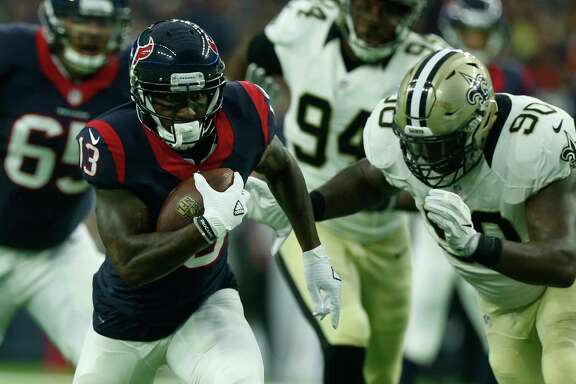 Houston Texans wide receiver Braxton Miller (13) runs past New Orleans Saints defensive tackle Nick Fairley (90) for an 11-yard reception during the first quarter of an NFL pre-season football game at NRG Stadium on Saturday, Aug. 20, 2016, in Houston. ( Brett Coomer / Houston Chronicle )