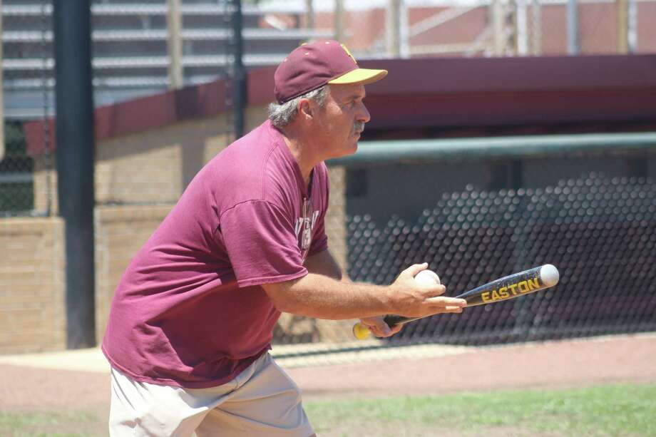 Head coach Chris Rupp gets ready to roll a baseball onto the infield during the team's final practice at Jim Kethan Field Wednesday. Photo: Robert Avery