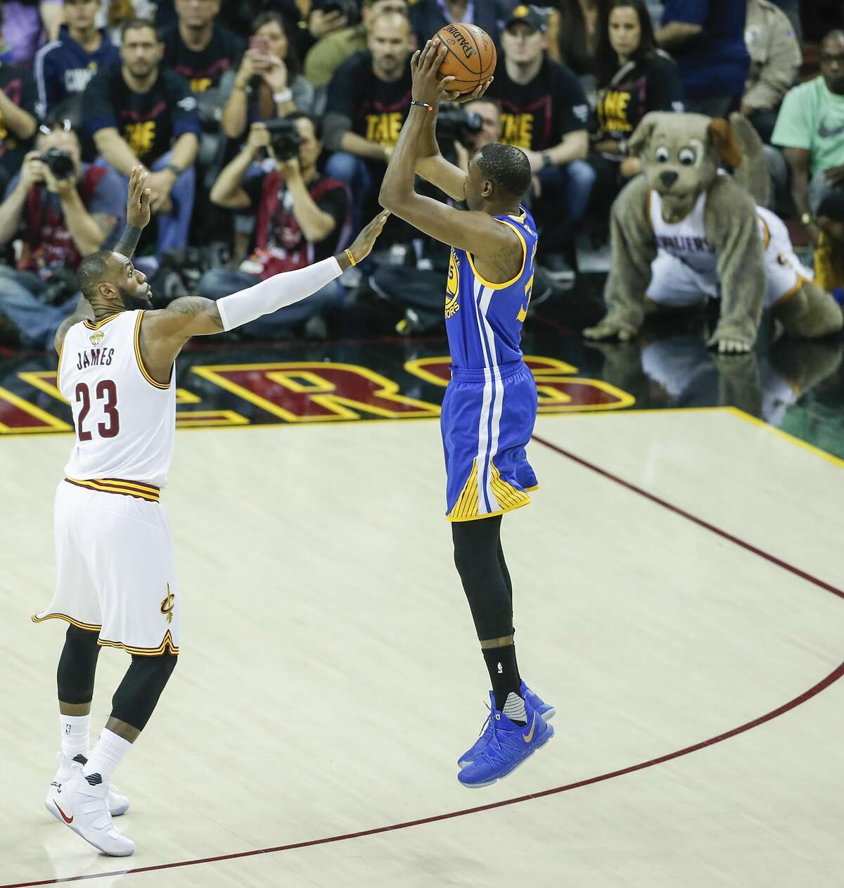 Golden State Warriors' Kevin Durant shoots over Cleveland Cavaliers' LeBron James.