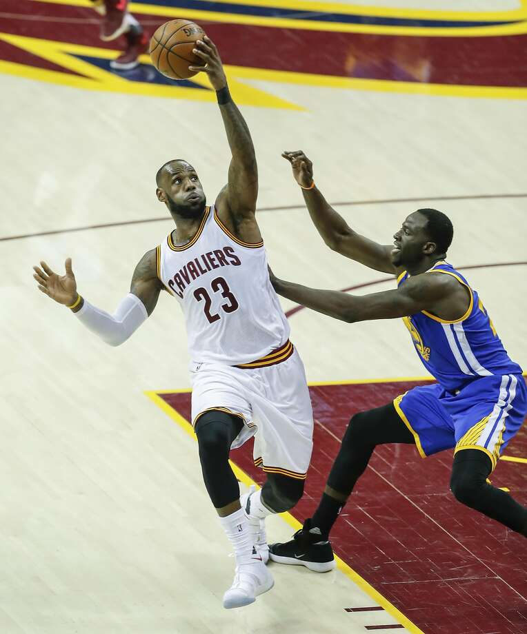 Golden State Warriors' Draymond Green defends against Cleveland Cavaliers' LeBron James in the second quarter during Game 3 of the 2017 NBA Finals at Quicken Loans Arena on Wednesday, June 7, 2017 in Cleveland, Ohio Photo: Scott Strazzante, The Chronicle