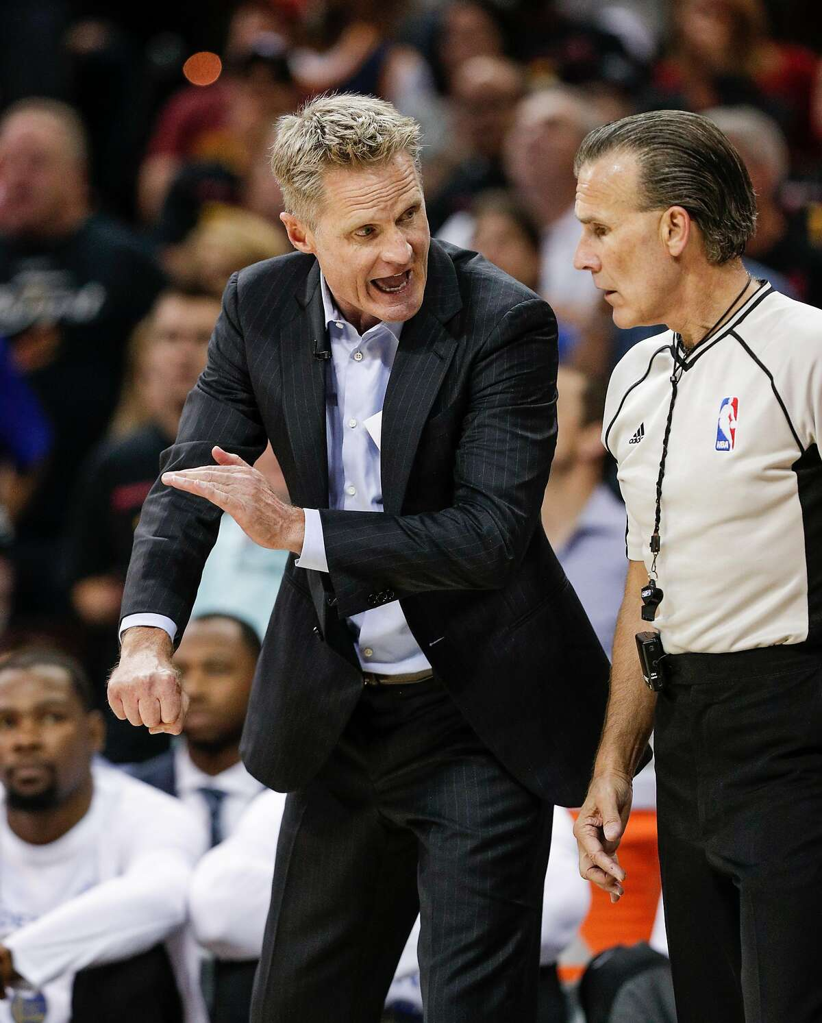 Golden State Warriors' Head Coach Steve Kerr talks to referee Ken Mauer in the second quarter during Game 3 of the 2017 NBA Finals at Quicken Loans Arena on Wednesday, June 7, 2017 in Cleveland, Ohio