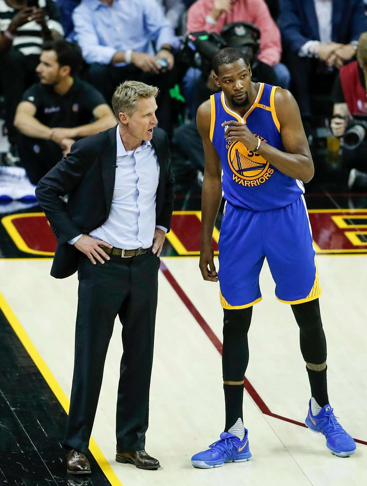 Golden State Warriors' Head Coach Steve Kerr and Kevin Durant talk in the third quarter during Game 3 of the 2017 NBA Finals at Quicken Loans Arena on Wednesday, June 7, 2017 in Cleveland, Ohio