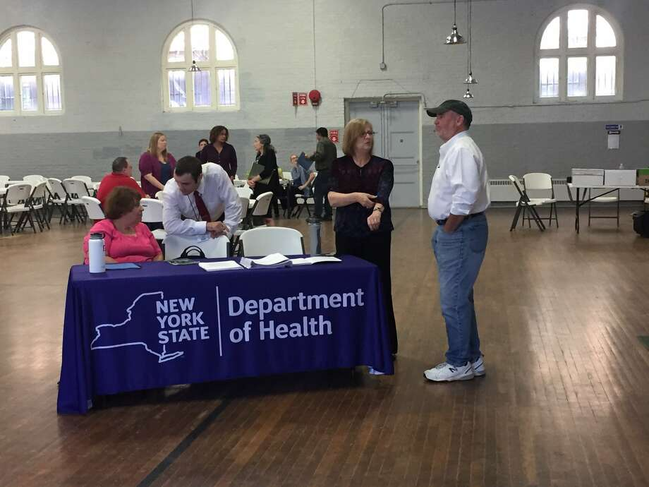There was a small turnout when the state Health Department conducted an information session Wednesday evening at the Hoosick Falls Armory, fielding questions from residents about the cancer report released this week. (Robert Downen / Times Union)
