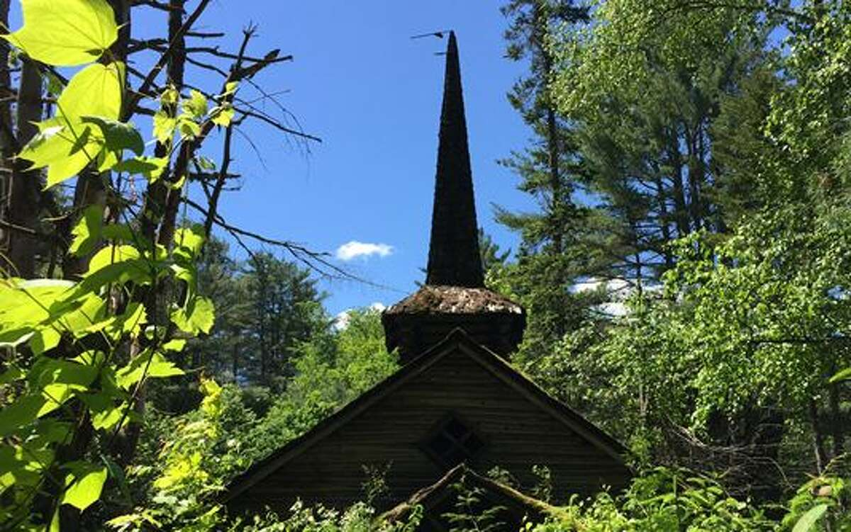 On Wednesday, June 8, 2017, officials from Empire State Development and the Department of Environmental Conservation offered a tour of the closed theme park to prospective developers and members of the media. Trees are growing up around what was the old church in Frontier Town (Rick Karlin / Times Union)
