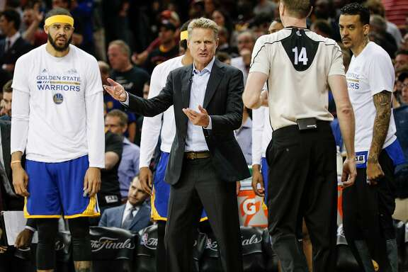 Golden State Warriors' Head Coach Steve Kerr talks to referee Ed Maloy in the second quarter during Game 3 of the 2017 NBA Finals at Quicken Loans Arena on Wednesday, June 7, 2017 in Cleveland, Ohio