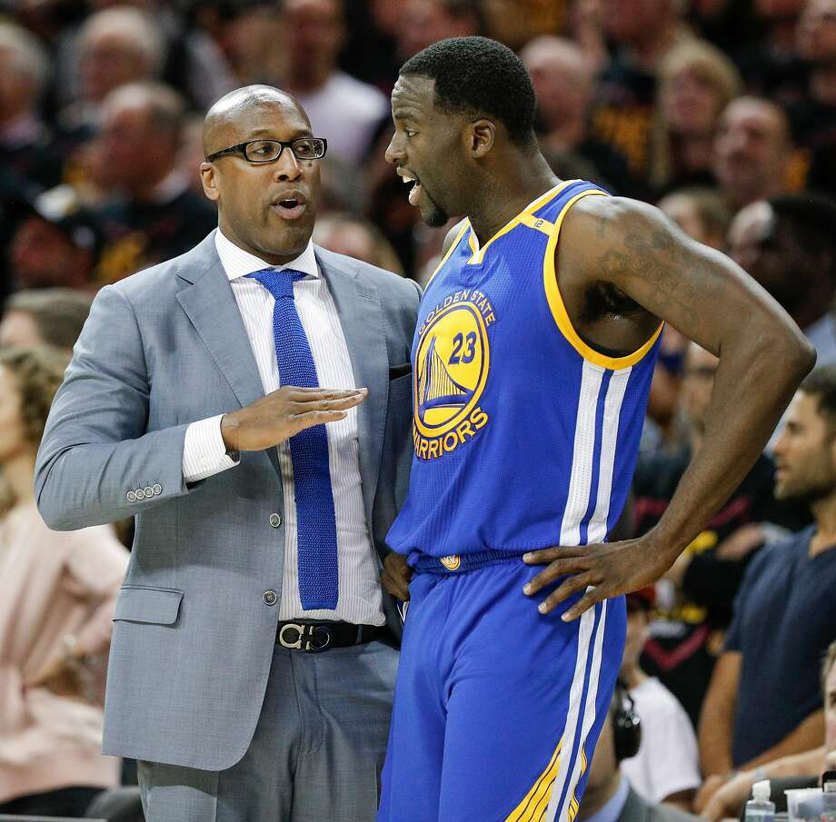 Golden State Warriors' Assistant Coach Mike Brown talks to Draymond Green in the second quarter during Game 3 of the 2017 NBA Finals at Quicken Loans Arena on Wednesday, June 7, 2017 in Cleveland, Ohio Photo: Carlos Avila Gonzalez, The Chronicle