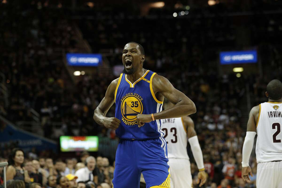 Golden State Warriors' Kevin Durant reacts in the fourth quarter during Game 3 of the 2017 NBA Finals at Quicken Loans Arena on Wednesday, June 7, 2017 in Cleveland, Ohio.
