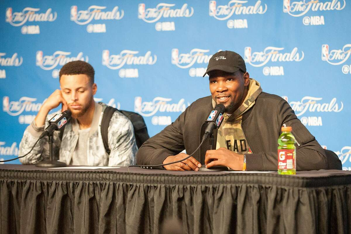 (l to r) Steph Curry and Kevin Durant of the Golden State Warriors answer questions following their win against the Cleveland Cavaliers in Game 3 of the 2017 NBA Finals at Quicken Loans Arena on Monday, June 7, 2017 in Cleveland, Ohio.