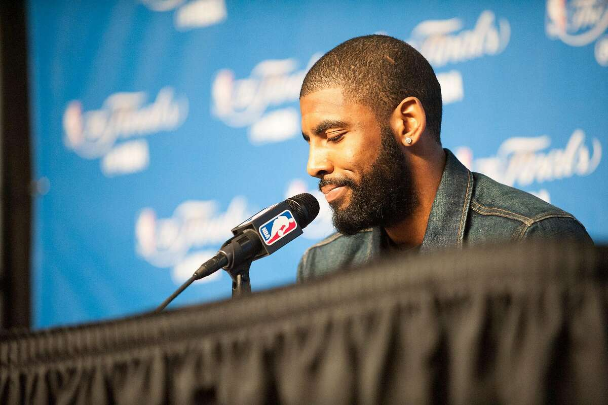 Kyrie Irving of the Cleveland Cavaliers answers questions following their loss to the Golden State Warriors in Game 3 of the 2017 NBA Finals at Quicken Loans Arena on Monday, June 7, 2017 in Cleveland, Ohio.