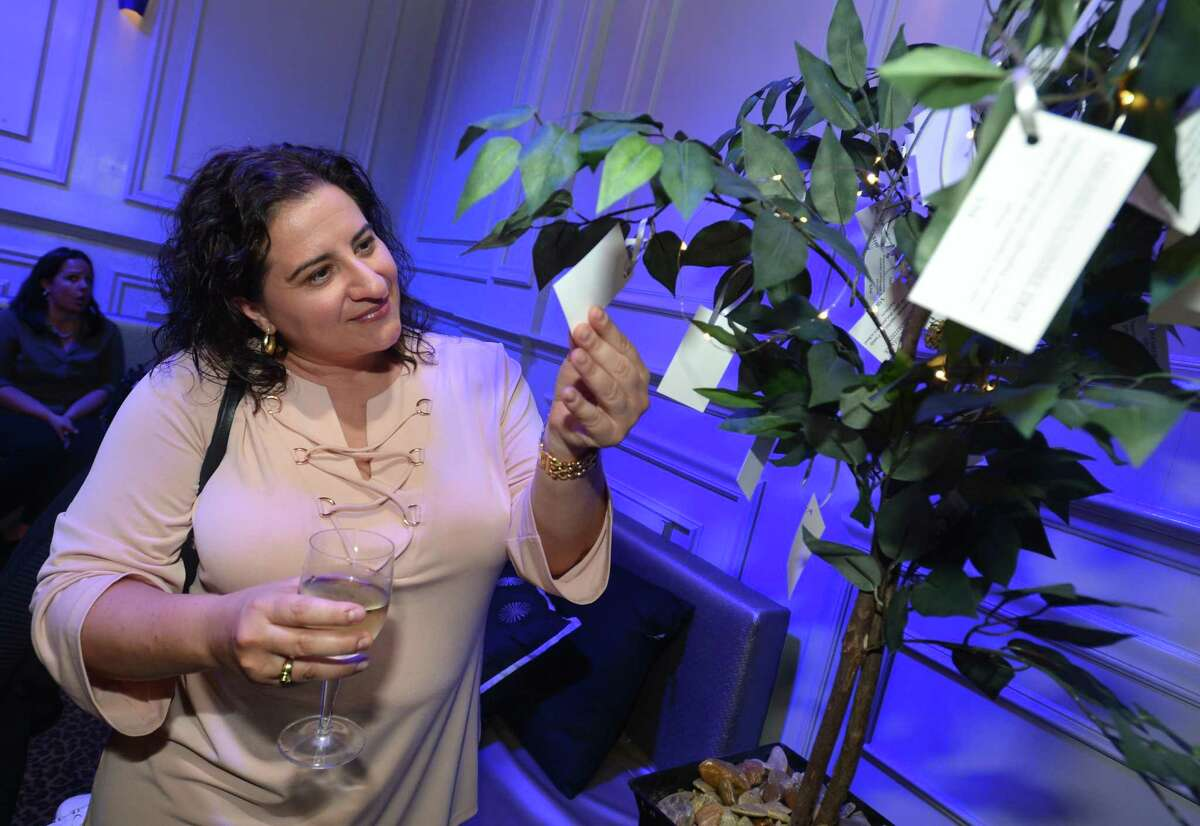 Filomena Fontana makes a choice on the wishing tree during the Human Services Council's biggest fundraiser of the year, the SoNo Stroll Benefit, now in its ninth year. The cocktail reception and auction at Mora Mora kicks off a night which also includes a three-course meal for guests at one of the events 10 participating SoNo restaurants, all proceeds from the event on Wednesday June 7, in Norwalk to benefit the Human Services Council.