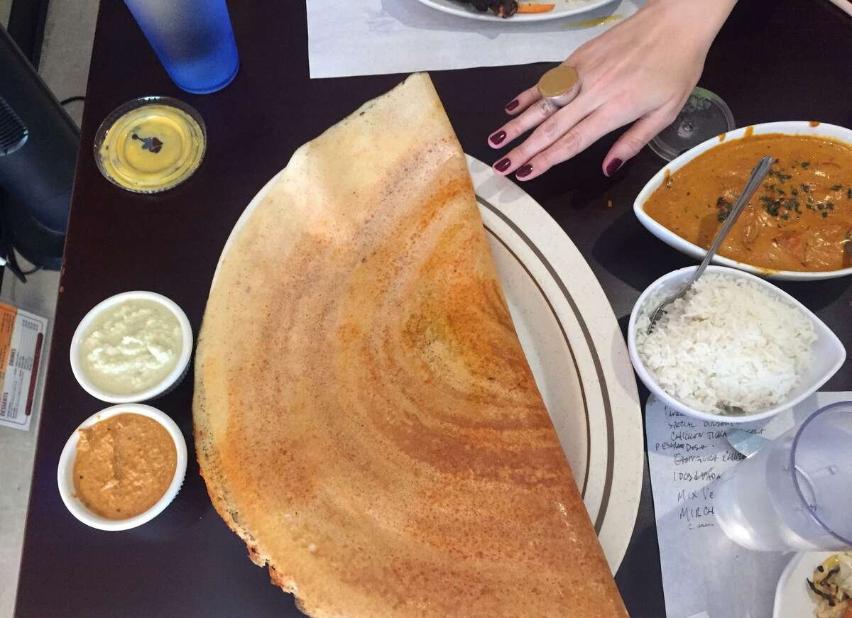 Make extra room on the table for the dosa at Amaravati Indian Cuisine. The large crepes made from a rice and lentil bater are served with a wide range of fillings.