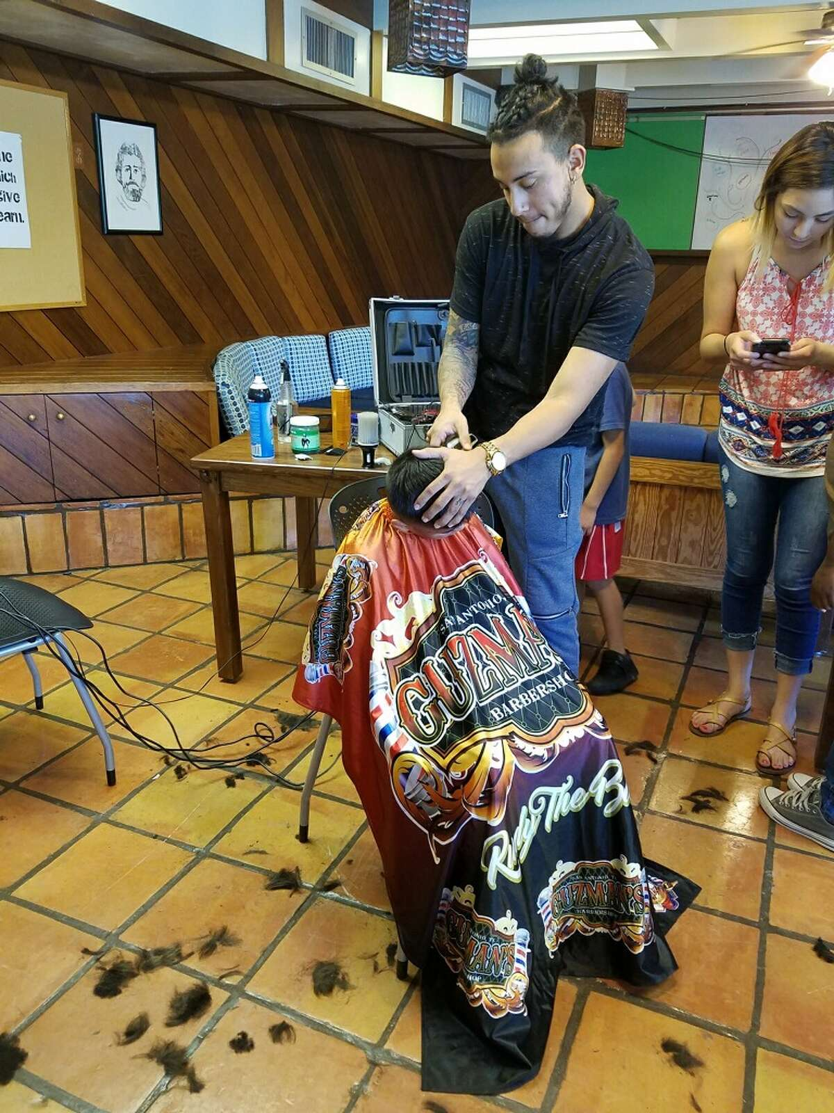 """This week, 22-year-old Rudy """"The Barber"""" Ibanez, proved he is still spreading goodwill throughout the city when gave 20 children haircuts at the Roy Maas Youth Alternative Meadowland Charter School in Boerne."""
