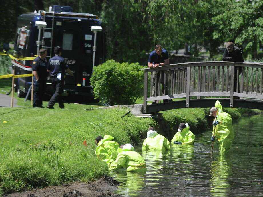 Investigators continue the investigation of found human remains by sweeping Binney Park in Old Greenwich, Conn. Thursday, June 8, 2017. Decomposed human remains were found in April at Helen Binney Kitchel Natural Park, located caddycorner to Binney Park and connected by a stream. The Connecticut State Police drive team, Greenwich police and the state D.E.E.P. searched the tidal areas of Binney Park for additional material on Thursday. Photo: Tyler Sizemore / Hearst Connecticut Media / Greenwich Time