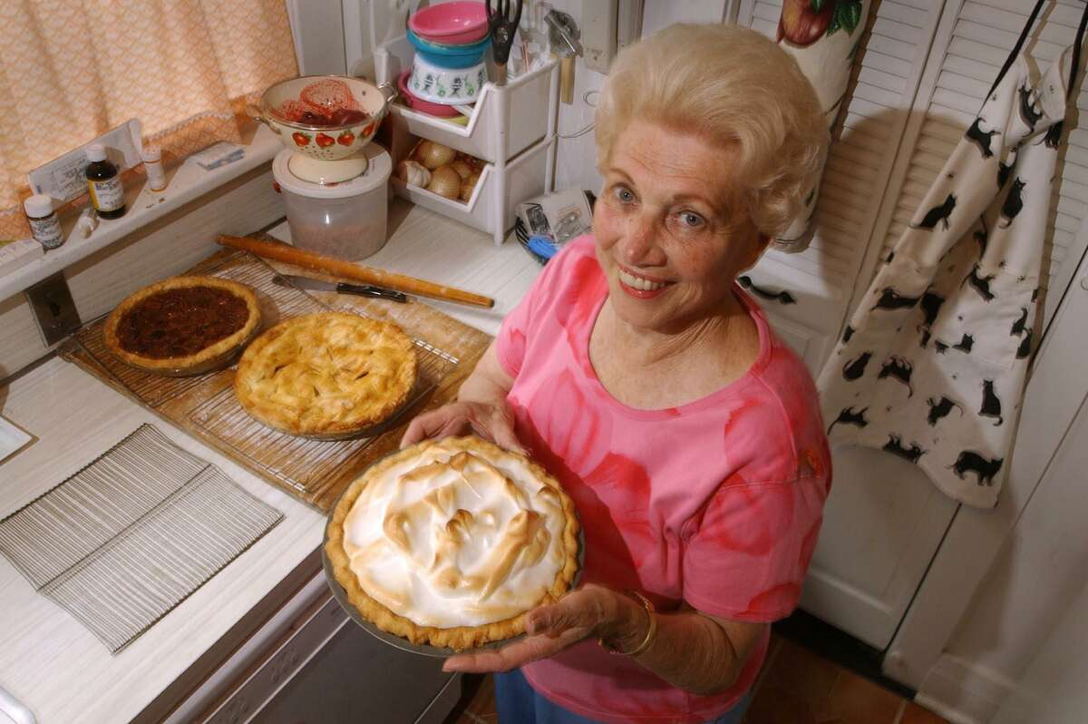 FILE - With her lemon meringue, Granny smith Apple, and Pecan pies, Pobie Johnston poses in her Shippan kitchen.