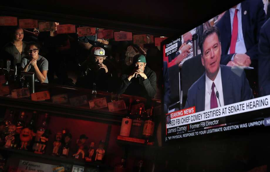 Patrons at Ace's Bar watch a television broadcast of former FBI Director James Comey testify before the Senate Intelligence Committee on June 8, 2017 in San Francisco, United States. People across the country are flocking to bars and restaurants to watch former FBI director as he testifies before the Senate Intelligence Committee about his conversations with U.S. President Donald Trump.  Photo: Justin Sullivan/Getty Images