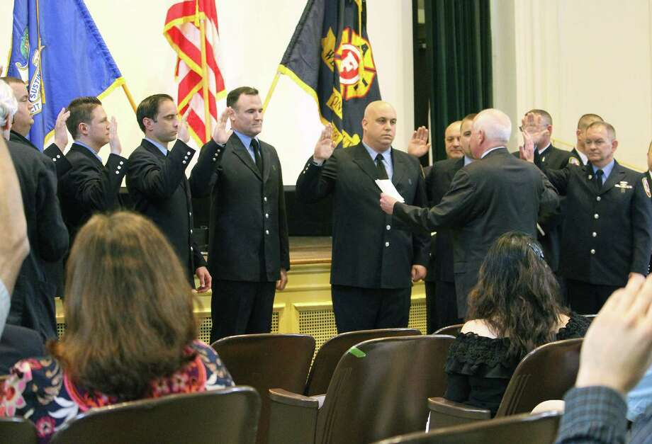 First Selectman Jim Marpe swears in firefighters promoted to lieutenants during a promotional ceremony at town hall. Photo: Laura Weiss / Hearst Connecticut Media / Westport News