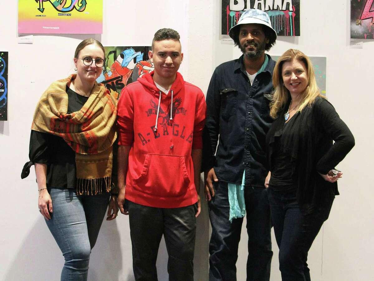 Westport Arts Center Director of Education Lillie Fortino, left, Bridge Academy student Gio Alvarez, artist Jahmane and Bridge Academy art and film teacher Jill Imse at 305 Knowlton, a Bridgeport, Conn. art gallery, on June 5, 2017.