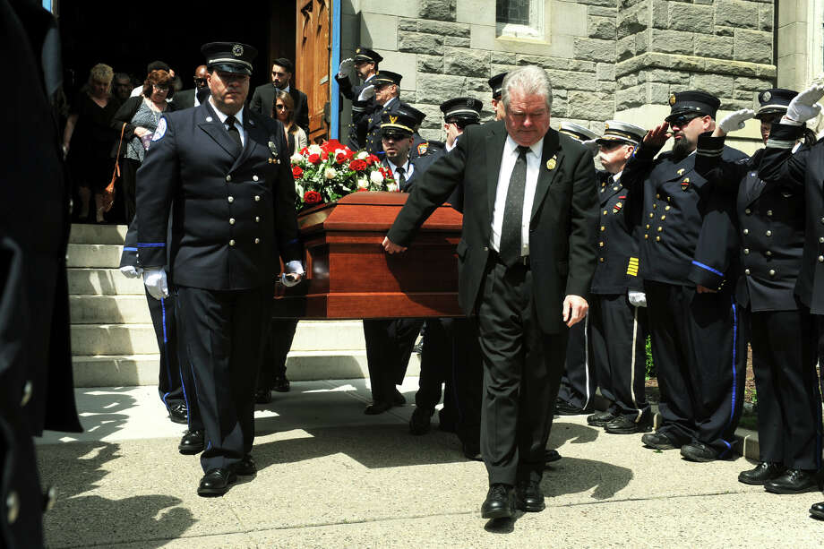 """The funeral for Seymour Volunteer Firefighter Kirk """"Mike"""" Weldon at Assumption Church, in Ansonia, Conn. for his funeral service June 8, 2017. Photo: Ned Gerard, Hearst Connecticut Media / Connecticut Post"""
