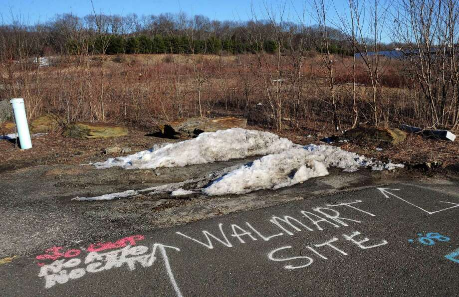 The site where a new Walmart will be built off of Victoria Drive is noted in spray paint on the pavement in Monroe, Conn., on Thursday Feb. 18, 2016. The big box retailer could break ground on the store this summer. Photo: Christian Abraham / Hearst Connecticut Media / Connecticut Post