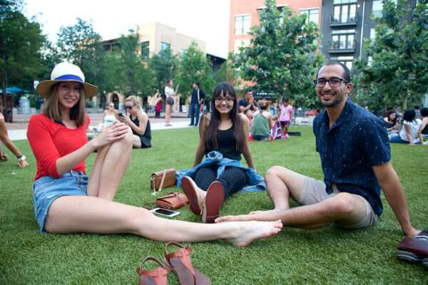 Katelyn Rose Marie Baumbusch, Maricela Hernandez, and Alexander Rodriguez sit on the lawn during the first Sound Cream Summer Session.