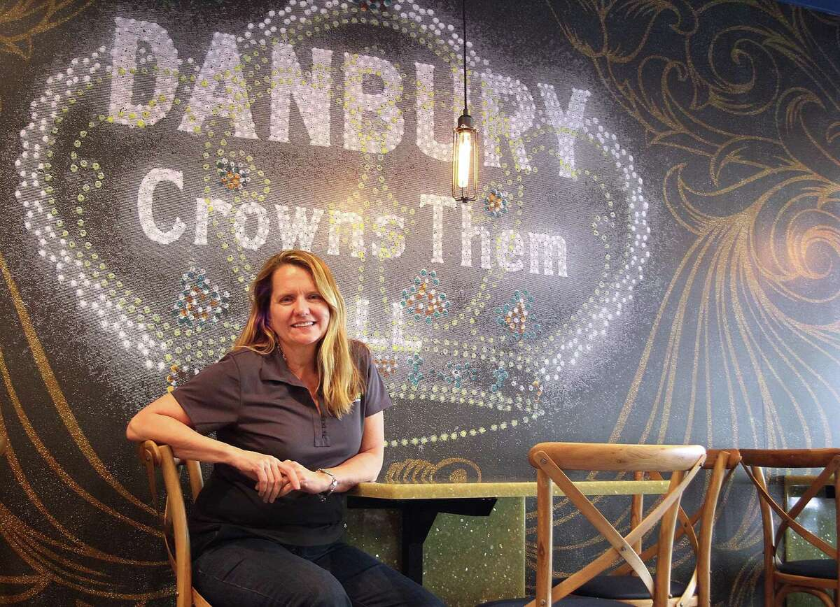 Andrea Gartner sits in her new cafe, Pour Me, on Main Street in Danbury on Wednesday.