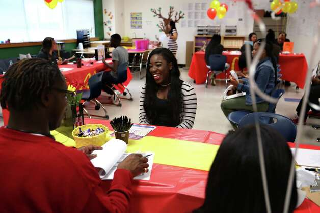 Shamoni Carouthers smiles after being offered a job at McDonalds during a job fair for youth ages 16-24 at Worthing High School on Saturday, April 29, 2017. (Annie Mulligan / Freelance) Photo: Annie Mulligan / For The Houston Chronicle / @ 2017 Annie Mulligan