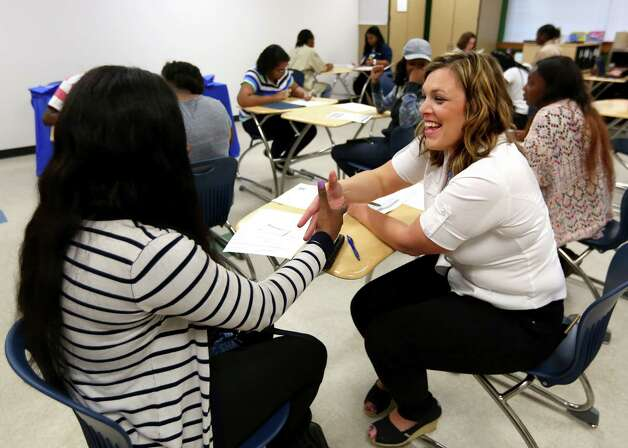 Shamoni Carouthers, left, shakes hands with Walmart Market Human Resources Manager Jennifer Hill during a job fair for youth ages 16-24 at Worthing High School on Saturday, April 29, 2017. (Annie Mulligan / Freelance) Photo: Annie Mulligan / For The Houston Chronicle / @ 2017 Annie Mulligan